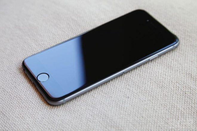 Alliance One Receivables - black smartphone
