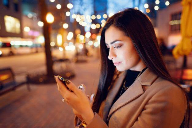 Allied Account Services - lady holding a smartphone