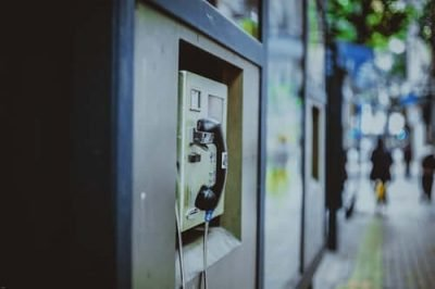 Associated Credit Services - a telephone booth