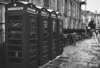 Augusta Collection Agency - a black and white image of a telephone booth
