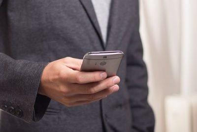 BCA Financial Services - a man holding a smartphone