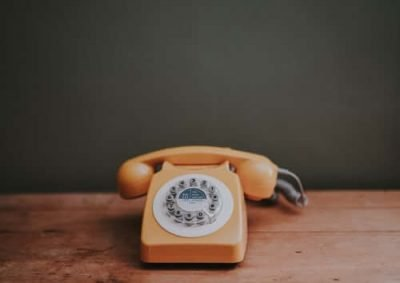 CMRE Financial Services - a yellow telephone