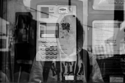 Central Research Inc - person in a telephone booth